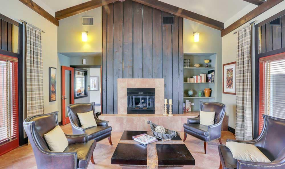Sienna at Cherry Creek's beautiful clubhouse interior with seating and a fireplace