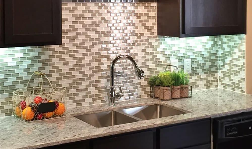 Beautiful tile backsplash in modern kitchen at 4000 Hulen Urban Apartment Homes