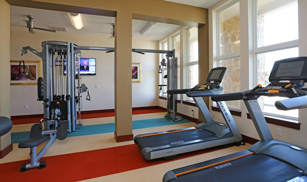 Treadmills, weights, and more at the fitness center at 4000 Hulen Urban Apartment Homes