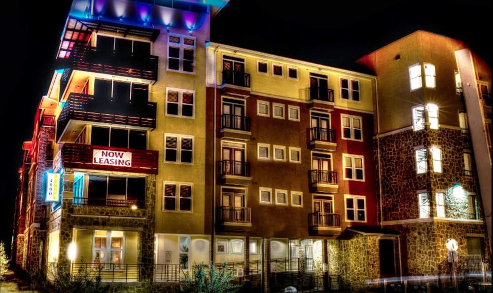 The 4000 Hulen Urban Apartment Homes building lit up at night