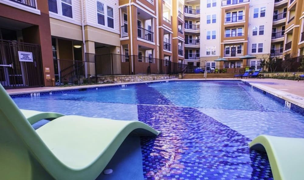View of the pool from the swim deck at 4000 Hulen Urban Apartment Homes in Fort Worth