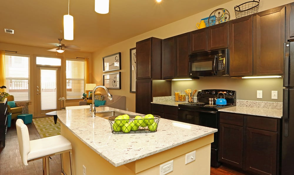 Modern and well-equipped kitchen in 4000 Hulen Urban Apartment Homes model home