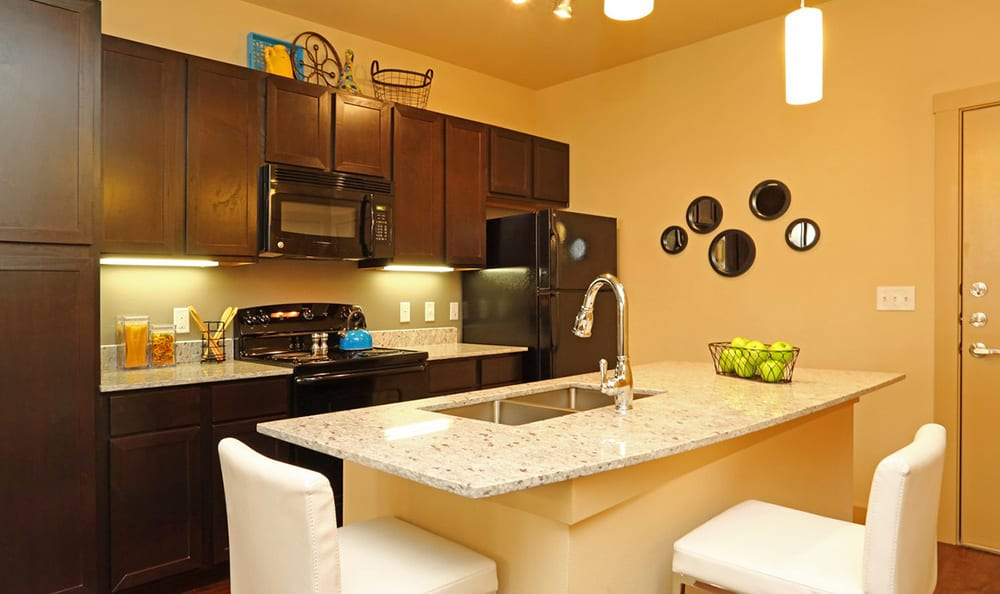 View of the stainless-steel appliances and island in model apartment home kitchen at 4000 Hulen Urban Apartment Homes