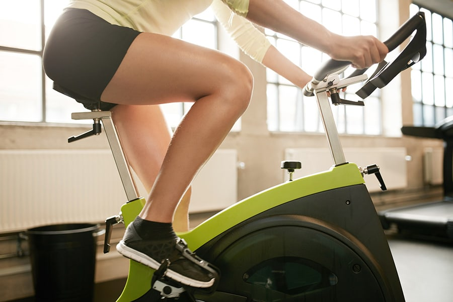 Riding the bike in the fitness center at 4000 Hulen Urban Apartment Homes