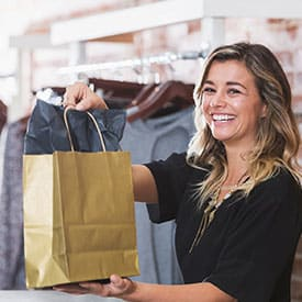Resident shopping at one of the many retail shops near 4000 Hulen Urban Apartment Homes