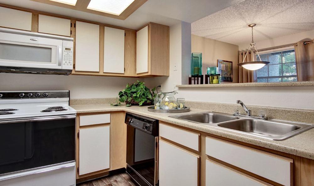 Enjoy apartments with a kitchen at Village at Desert Lakes