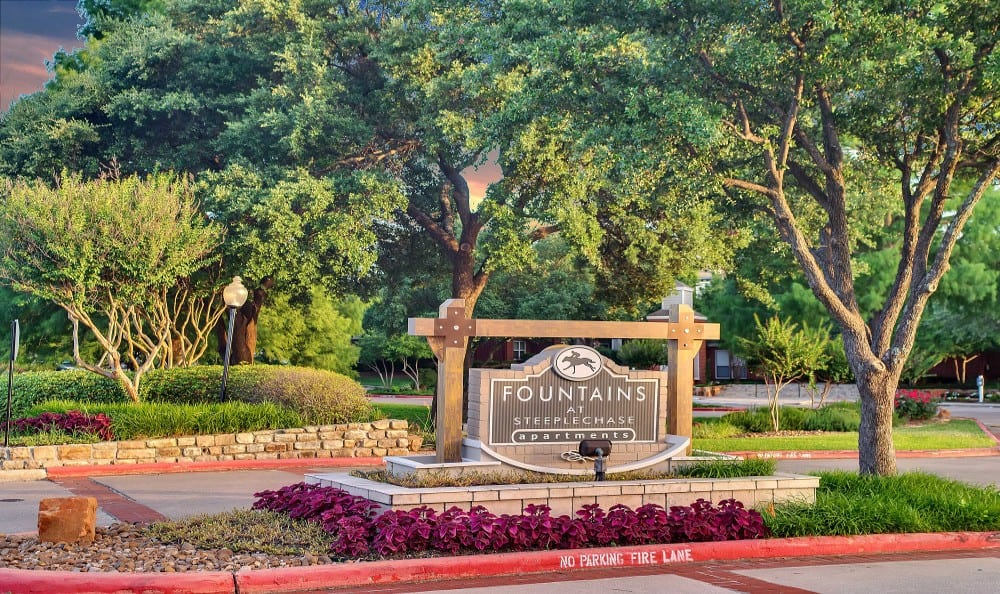 Exterior sign of Fountains at Steeplechase Apartments in Plano, TX