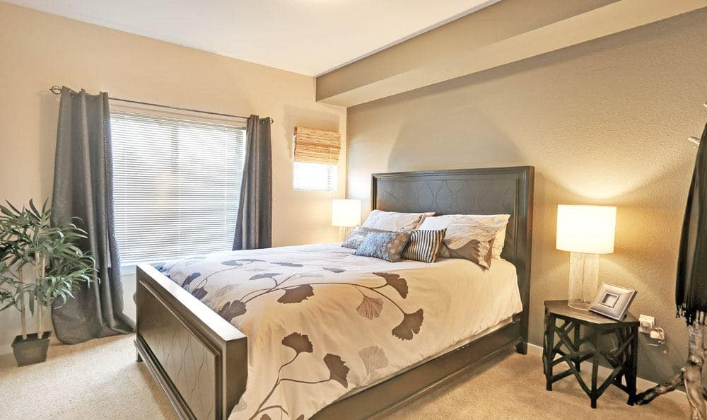 Beautiful bedroom at Downtown Belmar Apartments in Lakewood, Colorado