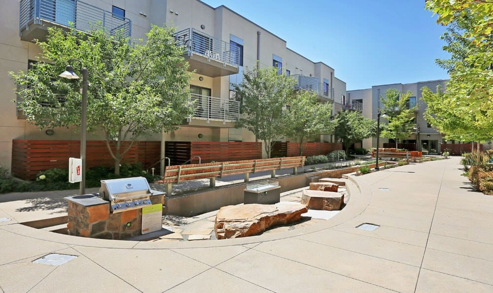A bbq area that is great for entertaining at Downtown Belmar Apartments in Lakewood, Colorado