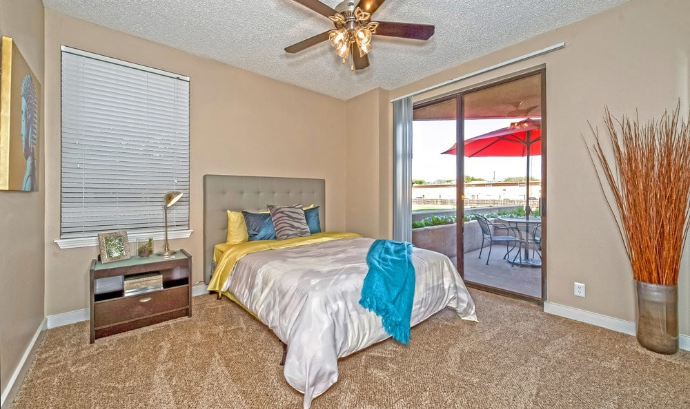 Beautiful bedroom at The Enclave at 1550 Apartments in San Antonio, Texas