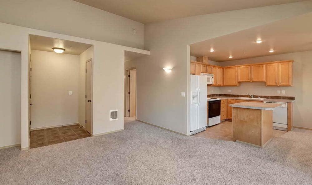 Well lit living area at Aravia Apartments in Tacoma, Washington