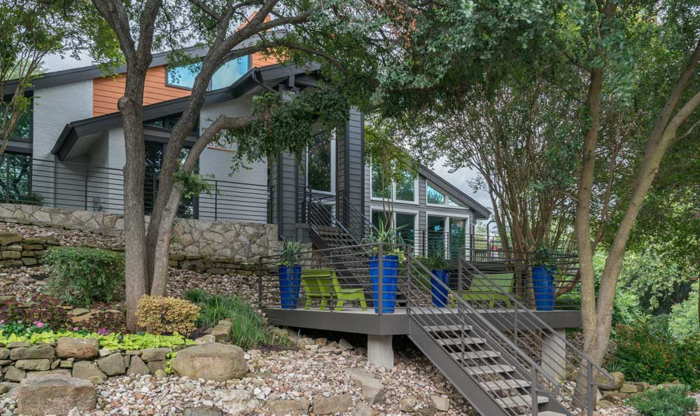 Exterior of the apartments clubhouse At Falls on Bull Creek Apartments In Austin TX