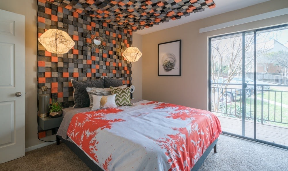Beautiful bedroom at Falls on Bull Creek Apartments in Austin, Texas