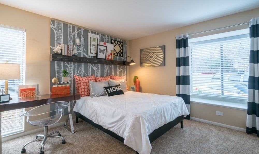 Falls on Bull Creek Apartments offers a luxury bedroom in Austin, Texas