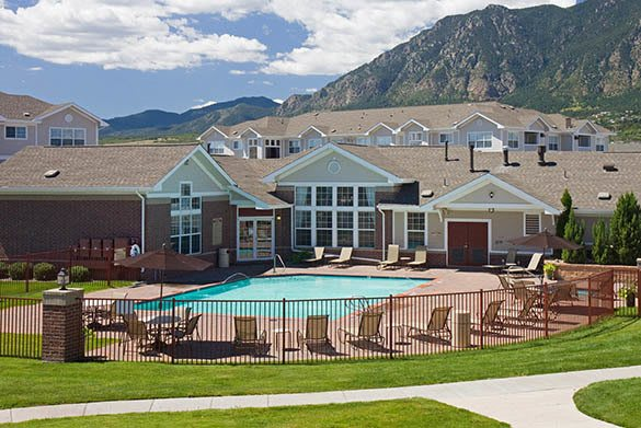 Clubhouse exterior and pool at Westmeadow Peaks Apartments in Colorado Springs, CO