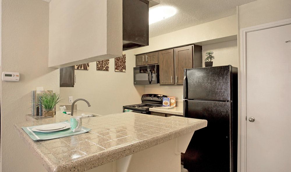Beautiful kitchen at Enclave at Water's Edge Apartments in Austin, Texas