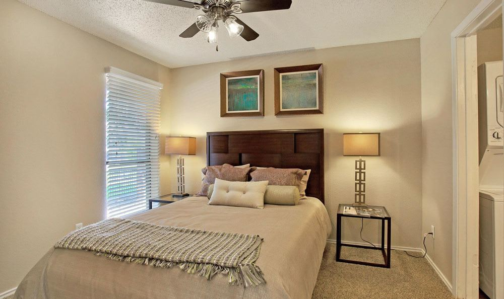 Beautiful bedroom at Enclave at Water's Edge Apartments in Austin, Texas