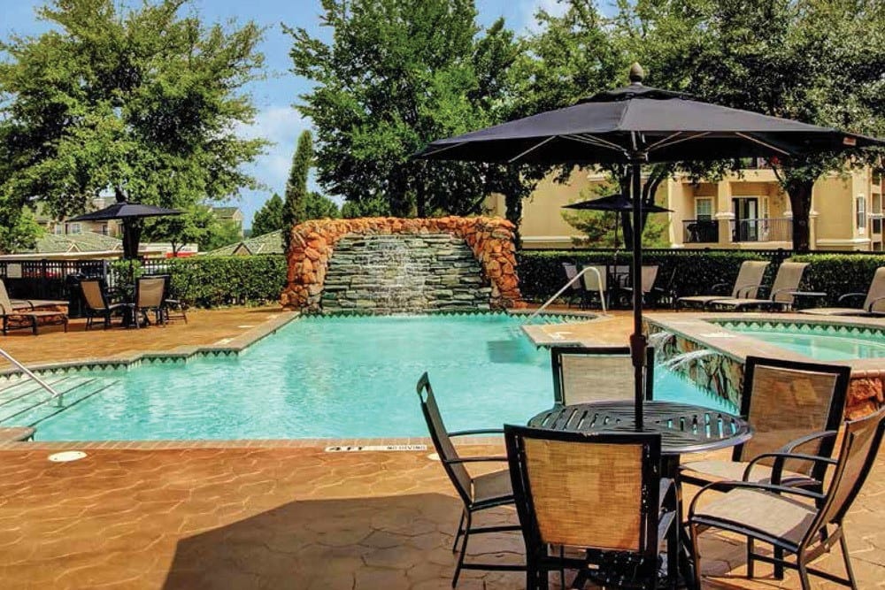 Relax poolside at The Gates at Buffalo Ridge Apartments