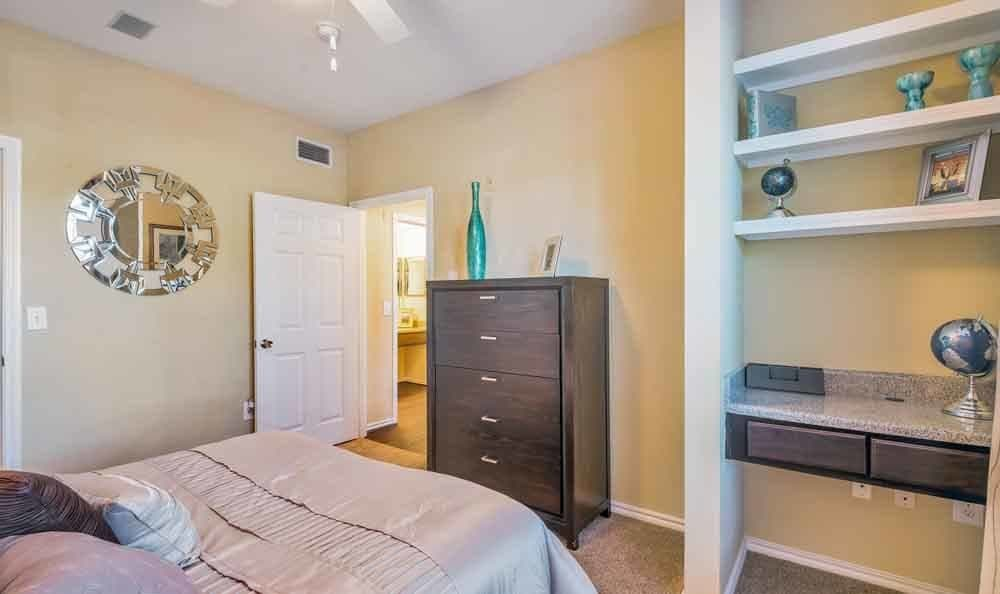 Ravinia Apartments offers a beautiful bedroom in Spring, Texas
