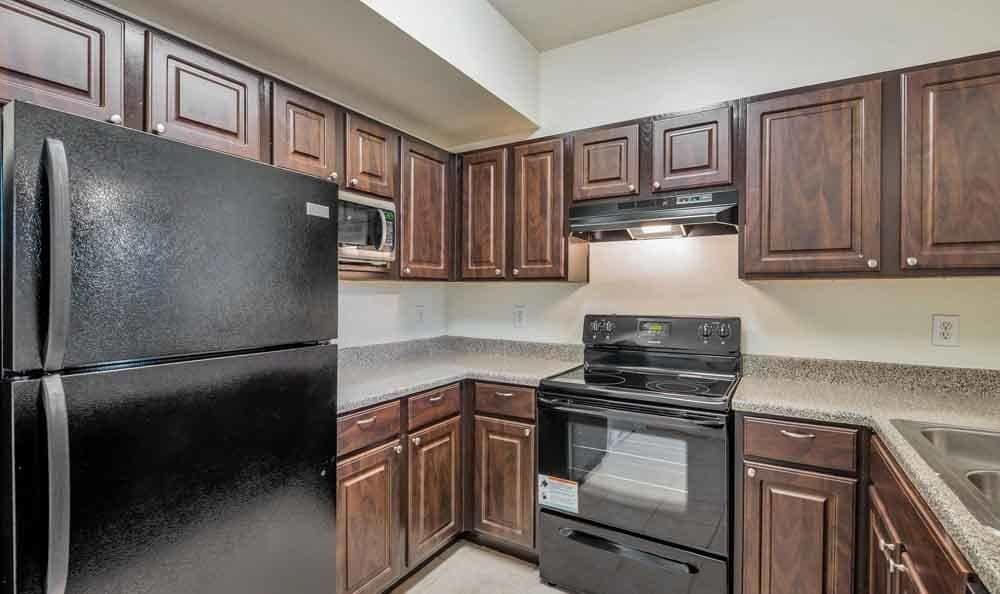 Ravinia Apartments offers a beautiful kitchen in Spring, Texas
