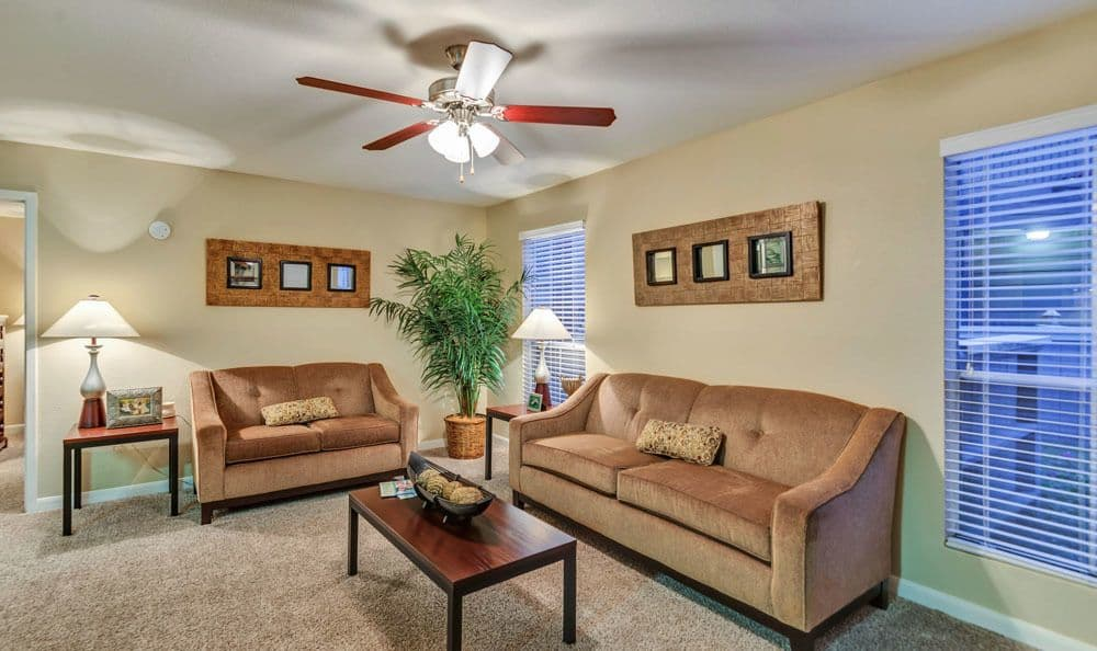 Modern living room at The Point at Cypress Woods Apartments in Cypress, Texas
