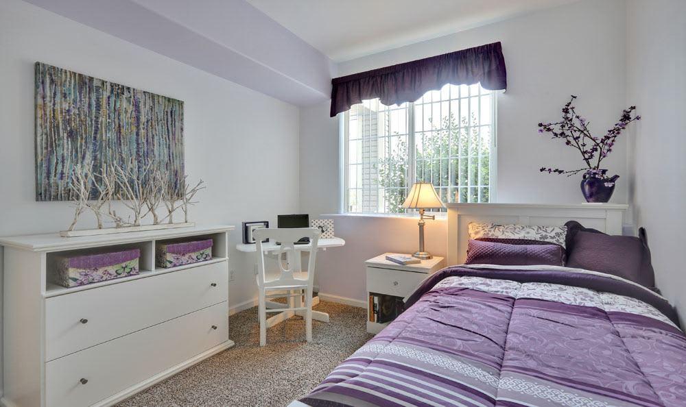 Naturally lit model bedroom at Vistas at Stony Creek Apartments in Littleton, Colorado