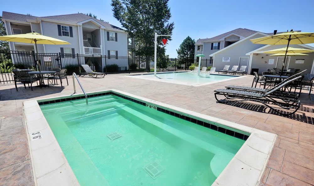 Lovely swimming pool area at Vistas at Stony Creek Apartments in Littleton, Colorado