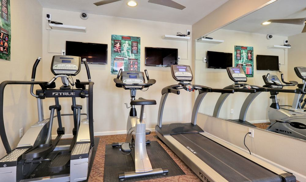 Treadmills in the fitness center at Vistas at Stony Creek Apartments in Littleton, Colorado