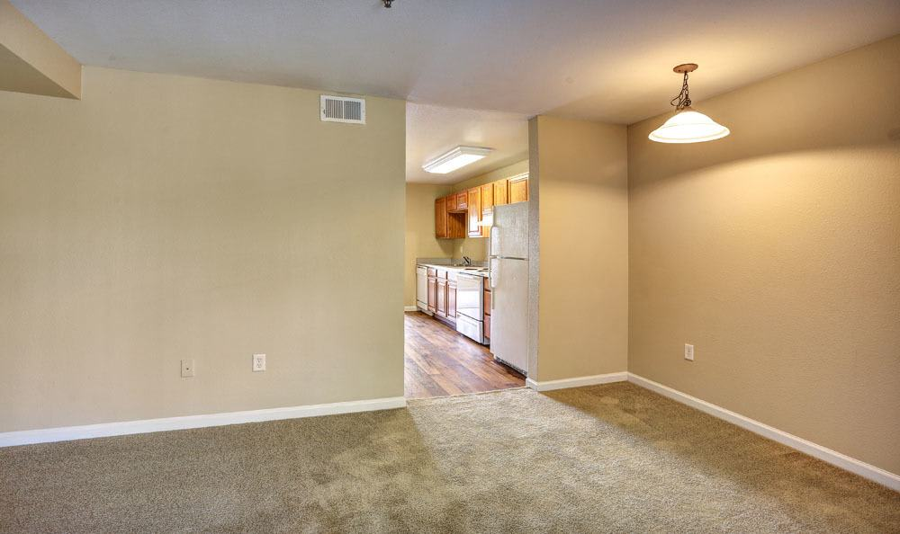 Spacious living room at Belle Creek Apartments in Henderson, Colorado