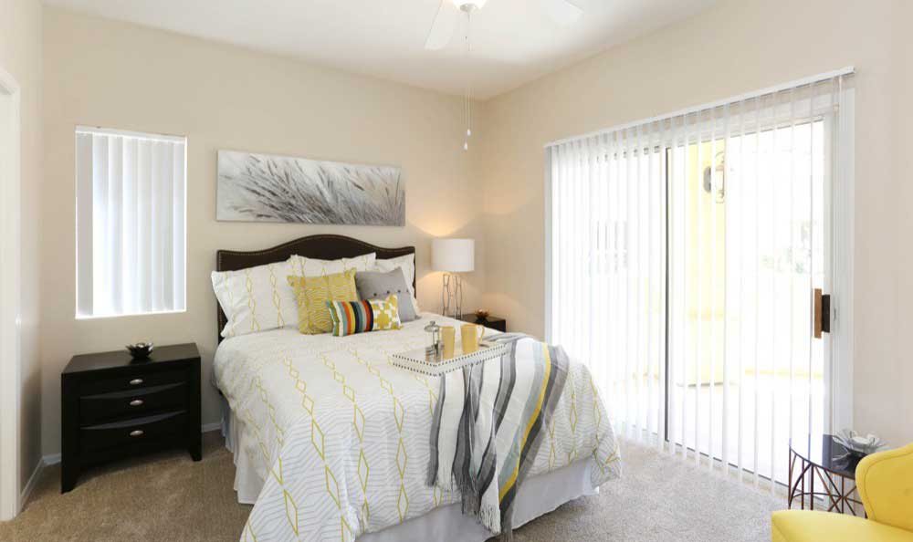 Modern bedroom at Tresa at Arrowhead Apartments in Glendale, AZ