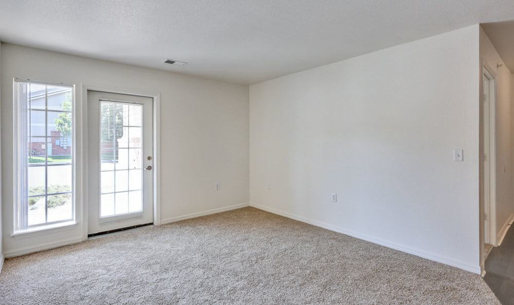 Buffalo Run Apartments offers a spacious living room in Fort Collins, Colorado
