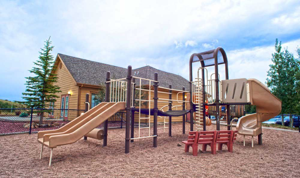 A Childrens play structure is onsite for your enjoyment at Gold Mountain Village Apartments