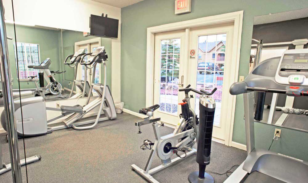Fitness center at Gold Mountain Village Apartments