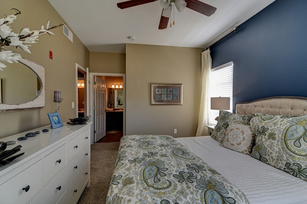 Model bedroom at The BLVD at Medical Center Apartments