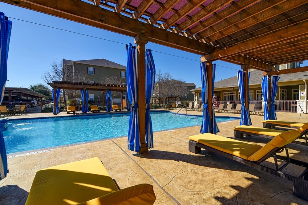 Resort-style pool features fountains and cabanas at The BLVD at Medical Center Apartments
