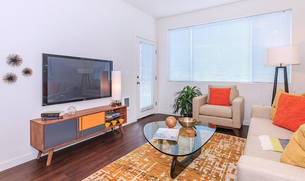 Bright and inviting living room at Ecco Apartments in Eugene, OR