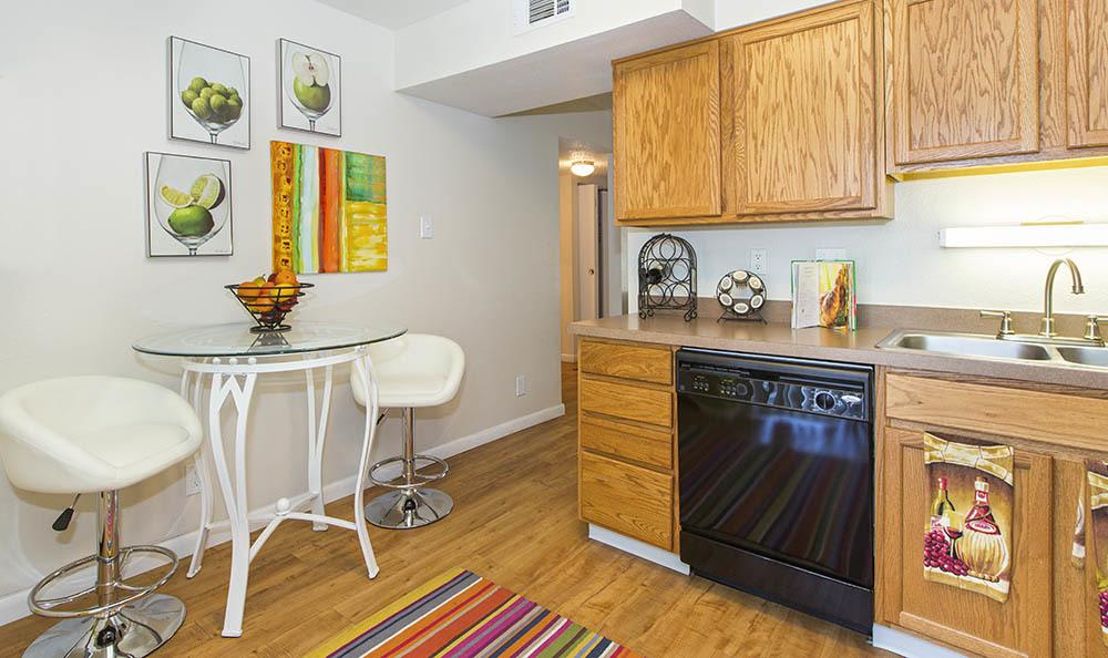 Kitchen with dining area at Broadmoor Ridge Apartment Homes in Colorado Springs, Colorado