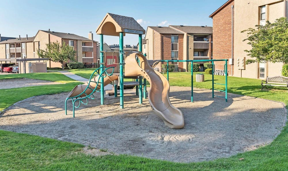 Cherry Creek Apartments offers a beautiful playground in Riverdale, UT