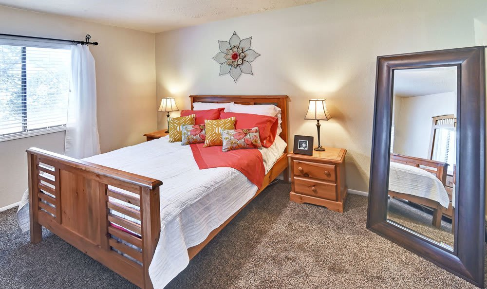 Spacious bedroom at Cherry Creek Apartments in Riverdale, Utah