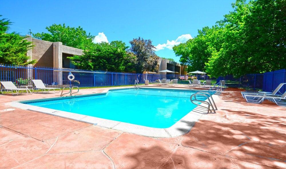 Pool and sun deck at Indigo Park in Albuquerque, NM