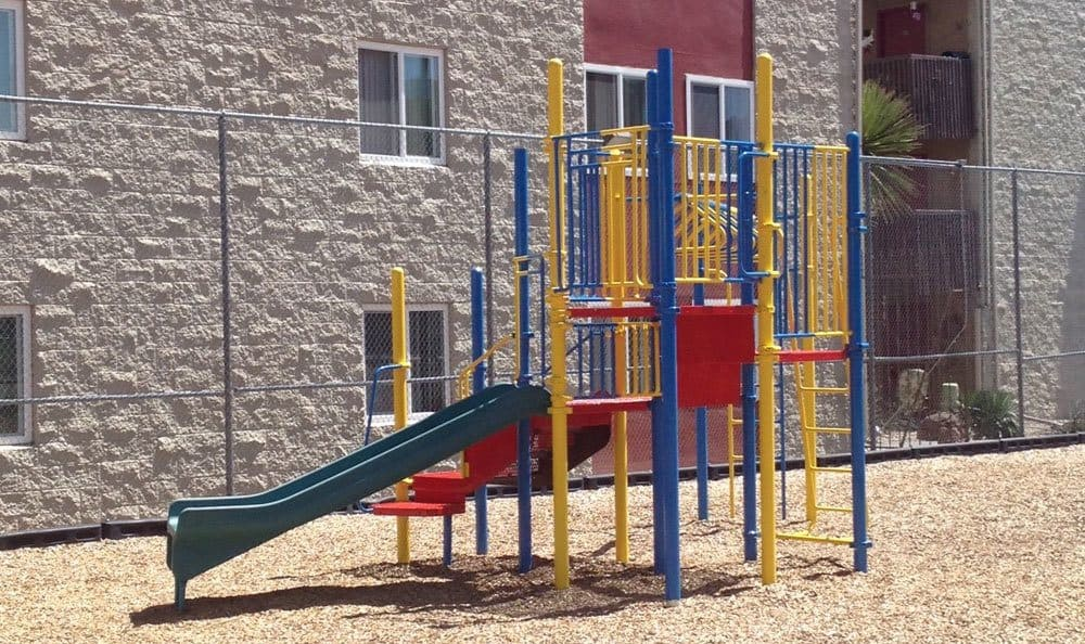 Playground with a slide at Albuquerque apartments