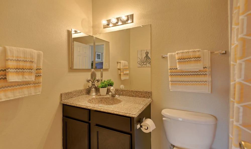 Bathroom at Villages at Parktown Apartments in Deer Park, Texas