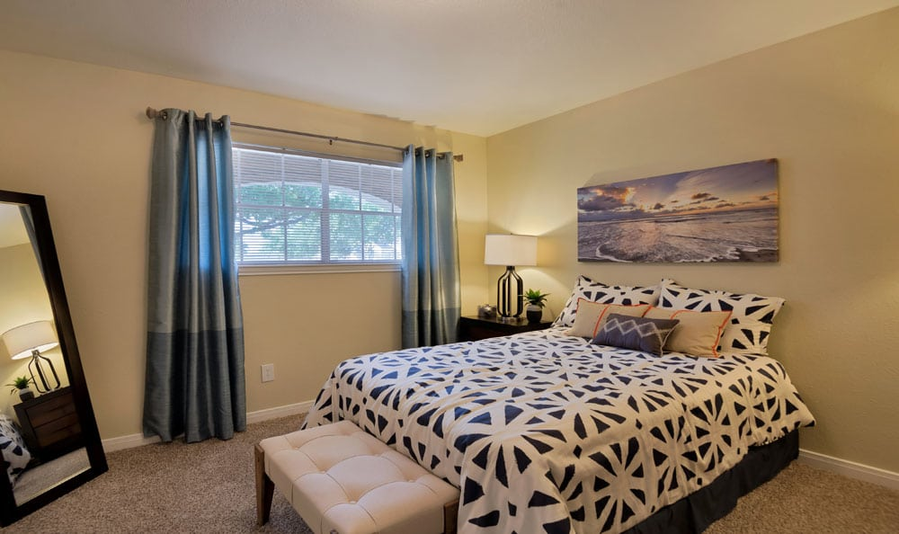 Villages at Parktown Apartments offers a beautiful bedroom in Deer Park, Texas