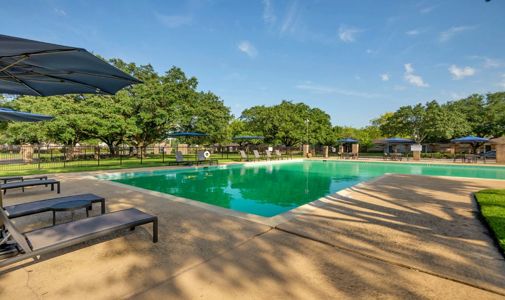 Beautiful swimming pool at Villages at Parktown Apartments in Deer Park, Texas