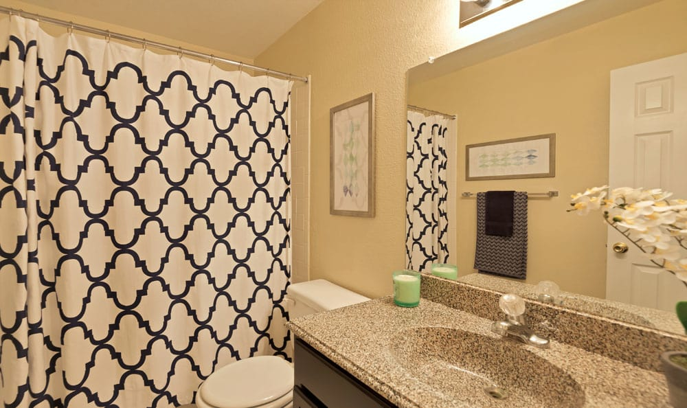 Villages at Parktown Apartments offers a bathroom in Deer Park, Texas
