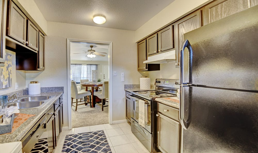 Villages at Parktown Apartments offers a beautiful kitchen in Deer Park, Texas