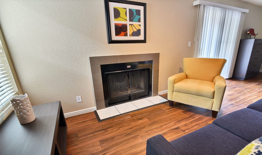 Seven65 Lofts offers a beautiful living room with fireplace in Salt Lake City, Utah