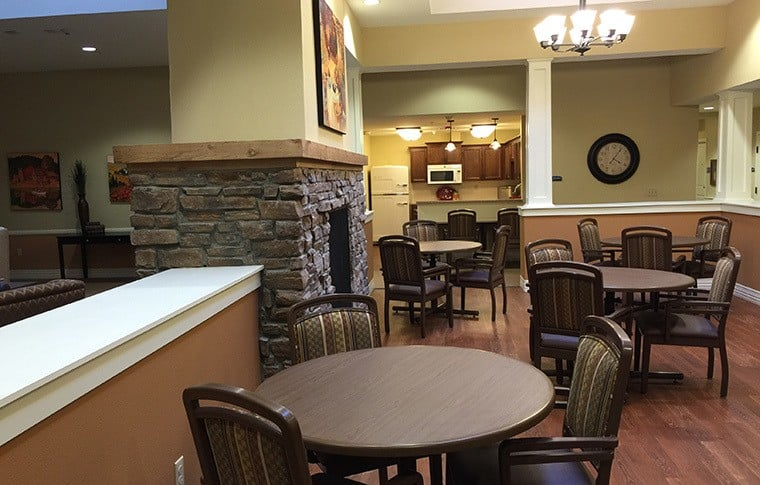 Another view of the dining room at New Dawn Memory Care, senior living in Colorado Springs, CO