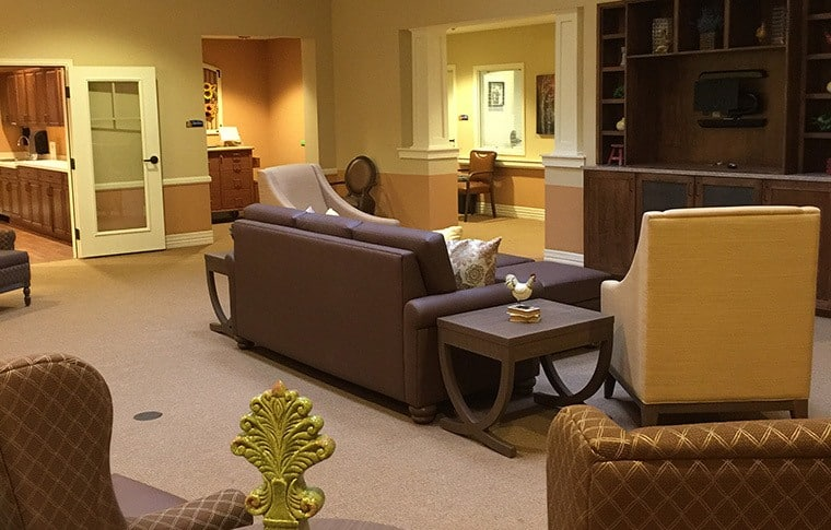 The interior decoration at New Dawn Memory Care in Colorado Springs is warm, inviting, and reminiscent of the styles of yesteryear
