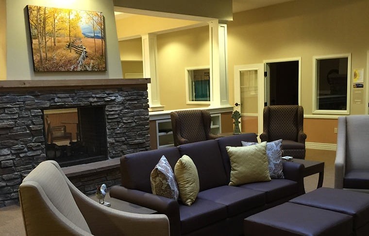 You'll find comfortable furniture throughout the common areas at our senior living community at New Dawn Memory Care in Colorado Springs